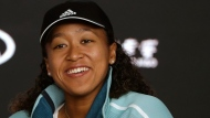 Japan's Naomi Osaka answers questions at a press conference following her win over Karolina Pliskova of the Czech Republic in their semifinal at the Australian Open tennis championships in Melbourne, Australia, Thursday, Jan. 24, 2019. (AP Photo/Mark Schiefelbein)