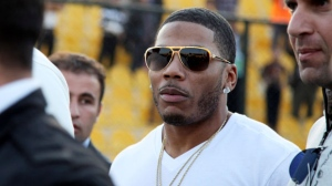 In this March 13, 2015 file photo, rapper Nelly approaches the stage for a concert in Irbil, northern Iraq. The St. Louis-based rapper is asking the federal court in his hometown to dismiss a British woman's lawsuit alleging that he sexually assaulted her after a concert in England. The lawsuit filed in November 2018 accused Nelly, whose real name is Cornell Haynes Jr., of an assault in December 2017. (AP Photo/Seivan M. Salim, File)