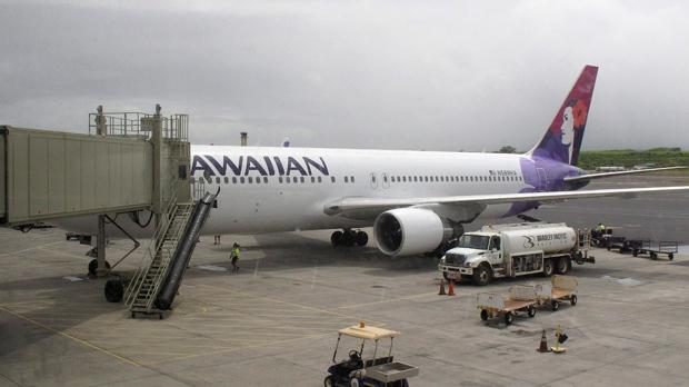 Plane makes emergency landing after flight attendant dies