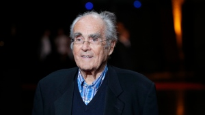 "In this Monday, Oct. 13, 2014 file picture French conductor Michel Legrand arrives at the opening ceremony of the 6th Lumiere Festival, in Lyon, central France. Oscar-winning composer and pianist Michel Legrand, whose hits included the score for ""The Umbrellas of Cherbourg"" and the song ""The Windmills of Your Mind"" and who left a lasting imprint on France's musical universe, has died at age 86. (AP Photo/Laurent Cipriani, File)"