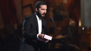 Shia LeBeouf introduces a performance by Sia at the 57th annual Grammy Awards on Sunday, Feb. 8, 2015, in Los Angeles. (Photo by John Shearer/Invision/AP)