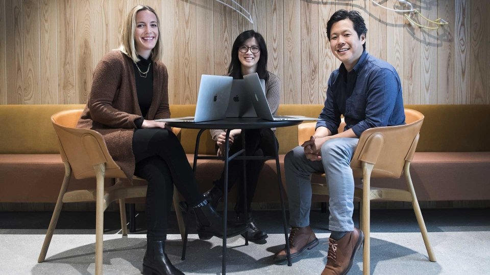 Kristy Bates, left, head of sales, Uber Eats Canada, Faye Pang, centre, head of restaurant success, Uber Eats Canada and Dan Park, general manager and head of Uber Eats Canada pose for a photograph at their downtown office space in Toronto on Friday, January 18, 2019. THE CANADIAN PRESS/Nathan Denette