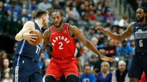 Toronto Raptors forward Kawhi Leonard (2) defends Dallas Mavericks forward Luka Doncic (77) as center DeAndre Jordan (6) looks on during the first half of an NBA basketball game in Dallas, Sunday, Jan. 27, 2019. (AP Photo/LM Otero)