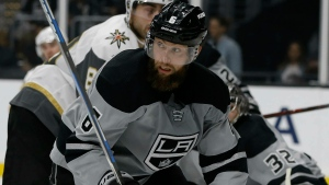 This Dec. 8, 2018, file photo shows Los Angeles Kings defenseman Jake Muzzin eyeing the puck during the third period of an NHL hockey game in Los Angeles. (AP Photo/Alex Gallardo, File)