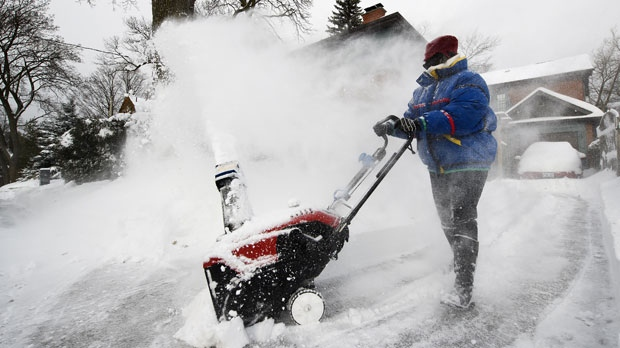 A women uses a snowblower to dig out from the snow after Toronto and most of southern Ontario got hit by a storm in Toronto on Tuesday, January 29, 2019. THE CANADIAN PRESS/Nathan Denette