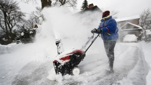 A woman uses a snowblower to dig out from the snow after Toronto and most of southern Ontario got hit by a storm in Toronto on Tuesday, January 29, 2019. THE CANADIAN PRESS/Nathan Denette