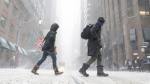 Pedestrians brave the blowing snow as a storm front moved in Toronto Monday, January 28, 2019, bringing show and expected low temperatures overnight. THE CANADIAN PRESS/Graeme Roy