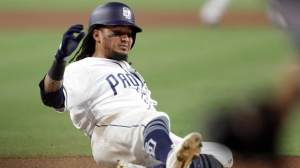 San Diego Padres' Freddy Galvis scores on a double by Hunter Renfroe during the first inning of a baseball game against the San Francisco Giants on Tuesday, Sept. 18, 2018, in San Diego. (AP Photo/Gregory Bull)