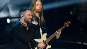 In this Sunday, March 11, 2018 file photo, Adam Levine, left, and James Valentine of Maroon 5 perform during the 2018 iHeartRadio Music Awards at The Forum in Inglewood, Calif.  (Photo by Chris Pizzello/Invision/AP, File)