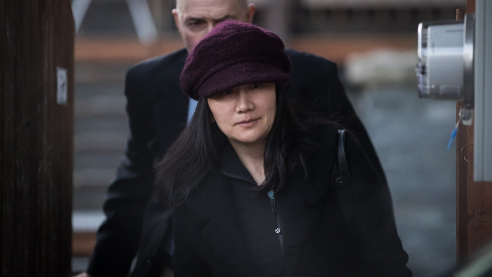 Huawei chief financial officer Meng Wanzhou leaves her home to attend a court appearance regarding her bail conditions, in Vancouver, on Tuesday January 29, 2019. THE CANADIAN PRESS/Darryl Dyck