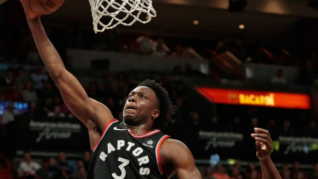 Miami Heat center Bam Adebayo (13) looks up as Toronto Raptors forward OG  Anunoby (3) scores during the first half of an NBA basketball game 81481c773