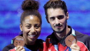 Canada's bronze medallists Jennifer Abel, left, and Francois Imbeau-Dulac hold their medals after the award ceremony for the mixed 3 meter springboard diving final at the 17th FINA World Championships 2017 in Budapest, Hungary, Saturday, July 22, 2017. It might have seemed like an innocuous gesture. But it was part of a much bigger problem that saw Canadian Francois Imbeau-Dulac lay down some of the best dives of his life at the 2012 London Olympics ??? and then completely fall apart. THE CANADIAN PRESS/AP/Michael Sohn