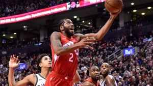 Toronto Raptors forward Kawhi Leonard (2) scores against the Milwaukee Bucks during second half NBA basketball action in Toronto on Thursday Jan. 31, 2019. THE CANADIAN PRESS/Frank Gunn