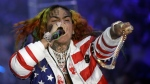 In this Sept. 21, 2018 file photo, rapper Daniel Hernandez, known as Tekashi 6ix9ine, performs during the Philipp Plein women's 2019 Spring-Summer collection during Fashion Week in Milan, Italy. (AP Photo/Luca Bruno, File)