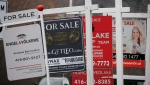 Real estate for sale signs are shown in Oakville, Ont. on Saturday, Dec.1, 2018. (THE CANADIAN PRESS/Richard Buchan)