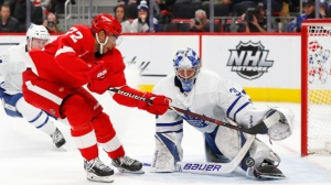 Toronto Maple Leafs goaltender Frederik Andersen (31) stops a Detroit Red Wings center Andreas Athanasiou (72) shot in overtime of an NHL hockey game, Friday, Feb. 1, 2019, in Detroit. (AP Photo/Paul Sancya)