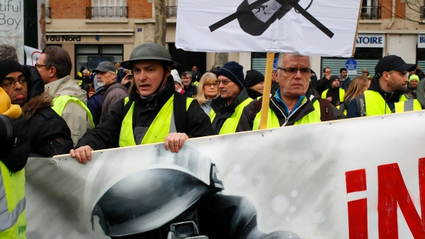 French yellow vest protesters back on the streets