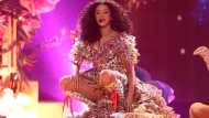 """In this Tuesday, Oct. 9, 2018 file photo, Cardi B performs """"I Like It"""" at the American Music Awards at the Microsoft Theater in Los Angeles. Cardi B says she received an offer to perform at the Super Bowl, but struggled with the decision to turn down the lucrative opportunity in support of ex-NFL player Colin Kaepernick. The Grammy-nominated rapper told The Associated Press on Friday, Feb. 1, 2019, that she had """"mixed feelings"""" after she declined to take the stage at Super Bowl 53 in Atlanta. (Photo by Matt Sayles/Invision/AP, File)"""