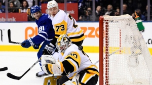 Pittsburgh Penguins goaltender Matt Murray (30) lets in a goal from Toronto Maple Leafs left wing Zach Hyman, not shown, as Toronto Maple Leafs centre John Tavares (91) and Pittsburgh Penguins defenceman Jack Johnson (73) look on during second period NHL hockey action in Toronto on Saturday, Feb. 2, 2019. THE CANADIAN PRESS/Nathan Denette