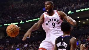 Toronto Raptors centre Serge Ibaka (9) reacts after dunking on L.A. Clippers guard Lou Williams (23)during first half NBA basketball action in Toronto on Sunday Feb. 3, 2019. THE CANADIAN PRESS/Frank Gunn
