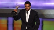 "FILE- In this June 20, 2008, file photo Kristoff St. John accepts the award for outstanding supporting actor in a drama series for his work on ""The Young and the Restless"" at the 35th Annual Daytime Emmy Awards in Los Angeles. John has died at age 52. Los Angeles police were called to John's home on Sunday, Feb. 3, 2019, and his body was turned over to the Los Angeles County coroner. The cause of death was not available. (AP Photo/Matt Sayles, File)"