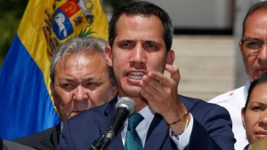 Opposition leader Juan Guaido, who has declared himself the interim president of Venezuela, speaks during a press conference on the steps of the National Assembly in Caracas, Venezuela, Monday, Feb. 4, 2019.  (AP Photo/Fernando Llano)