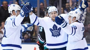 Toronto Maple Leafs left wing Andreas Johnsson (18) celebrates his goal with right wing William Nylander (29) and centre Patrick Marleau (12) during second period NHL hockey action against the Anaheim Ducks in Toronto on Monday, February 4, 2019. THE CANADIAN PRESS/Nathan Denette
