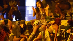 """In this Aug. 20, 2018, file photo, Ariana Grande, center, performs """"God is a woman"""" at the MTV Video Music Awards at Radio City Music Hall in New York.  (Photo by Chris Pizzello/Invision/AP, File)"""