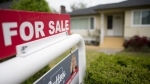 A real estate sign is pictured in Vancouver, B.C., Tuesday, June 12, 2018. (THE CANADIAN PRESS/Jonathan Hayward)
