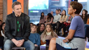 """This image released by ABC shows Irish actor Liam Neeson, left, with co-host Robin Roberts on """"Good Morning America,"""" Tuesday, Feb. 5, 2019, in New York. (Lorenzo Bevilaqua/ABC via AP)"""