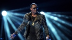 In this June 30, 2013 file photo, R. Kelly performs at the BET Awards at the Nokia Theatre in Los Angeles. R. Kelly is announcing a new tour, but it won't be in the United States. The embattled entertainer announced on social media Tuesday, Feb. 5, 2019, that he'll be going to Australia, New Zealand and Sri Lanka.  (Photo by Frank Micelotta/Invision/AP, File)
