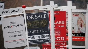 Real estate for sale signs are shown in Oakville, Ont. on Saturday, Dec.1, 2018. THE CANADIAN PRESS/Richard Buchan