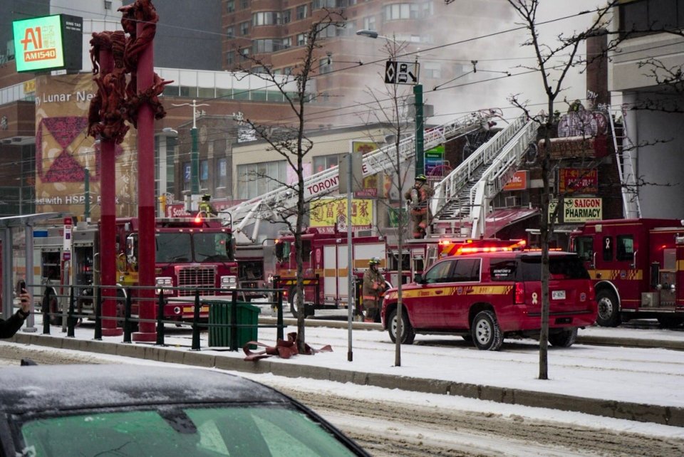 Crews battle a three-alarm fire at Spadina Avenue and Dundas Street in Toronto's Chinatown Wednesday February 6, 2019. (@TomasMakacek /Twitter)