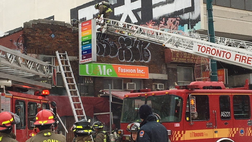 Crews work to put out a three-alarm fire at Spadina Avenue and Dundas Street in Toronto's Chinatown area Wednesday February 6, 2019. (Jee-Yun Lee /CP24)