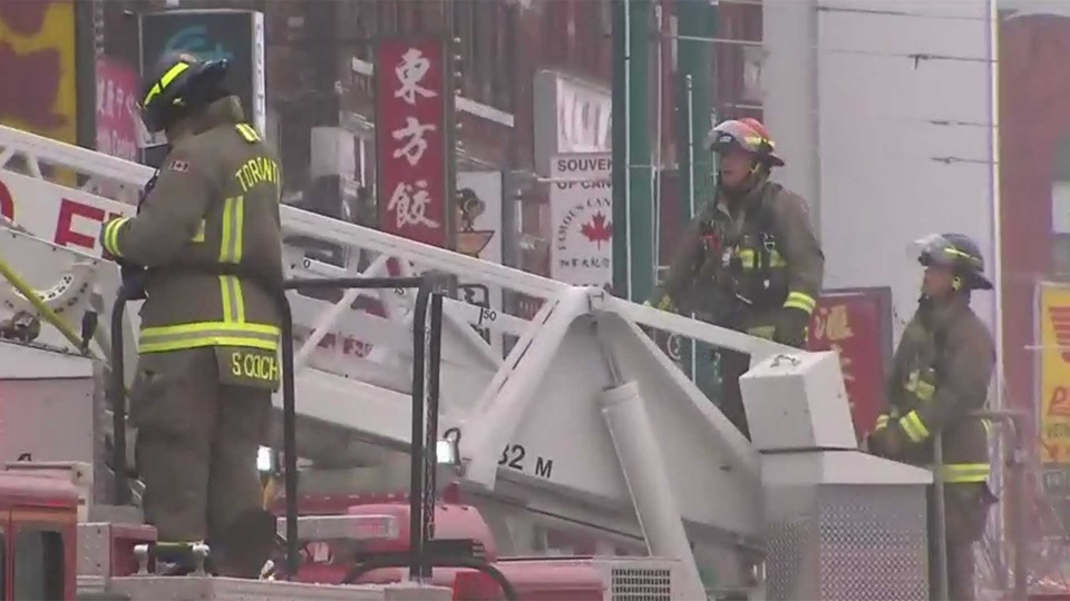 Crews work to put out a three-alarm fire at Spadina Avenue and Dundas Street in Toronto's Chinatown area Wednesday February 6, 2019.