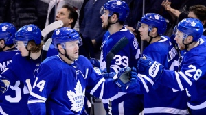 Toronto Maple Leafs defenceman Morgan Rielly (44) is congratulated on his goal during third period NHL hockey action against the Ottawa Senators, in Toronto on Wednesday, Feb.6, 2019. THE CANADIAN PRESS/Frank Gunn