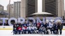 Toronto Maple Leafs players pose for a team photo following the team's outdoor practice at Nathan Phillips Square in front of City Hall in Toronto on Thursday February 7, 2019. THE CANADIAN PRESS/Frank Gunn