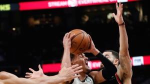 Atlanta Hawks guard Trae Young (11) works against Toronto Raptors guard Fred VanVleet (23) during the first half of an NBA basketball Thursday, Feb. 7, 2019, in Atlanta. (AP Photo/John Bazemore)