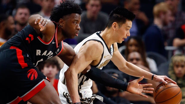 Atlanta Hawks guard Jeremy Lin (7) goes to the basket as Toronto Raptors forward OG Anunoby (3) defends during the first half of an NBA basketball Thursday, Feb. 7, 2019, in Atlanta. (AP Photo/John Bazemore)