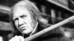 """In this Jan. 15, 1970 file photo, British actor Albert Finney waves his cane while playing the title role in """"Scrooge,"""" at Shepperton Studios. British Actor Albert Finney, the Academy Award-nominated star of films from """"Tom Jones"""" to """"Skyfall"""" has died at the age of 82 his family said on Friday, Feb. 8, 2019. (AP Photo/R. Dear, File)"""