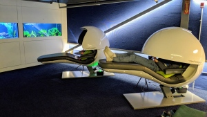 A Google Canada employee reclines on one of two nap pods at its offices in Kitchener, Ont., in this undated handout photo. THE CANADIAN PRESS/HO - Google Canada