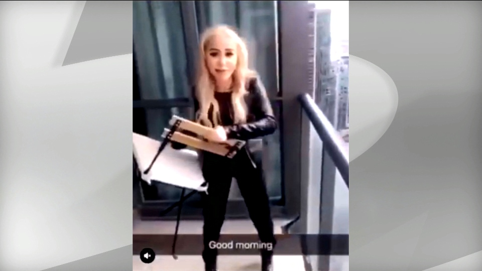 A woman is seen in a video circulating online throwing a chair off of a balcony of a highrise condo downtown.