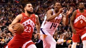 Toronto Raptors guard Fred VanVleet (23) drives to the basket as Phoenix Suns guard De'Anthony Melton (14) defends during first half NBA basketball action in Toronto on Thursday Jan. 17, 2019. THE CANADIAN PRESS/Frank Gunn