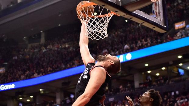 Toronto Raptors Marc Gasol makes a reverse dunk as Brooklyn Nets forward Ed Davis (17) looks on during second half NBA basketball action in Toronto on Monday, Feb. 11, 2019. THE CANADIAN PRESS/Frank Gunn