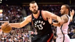 Toronto Raptors Marc Gasol controls the ball as Brooklyn Nets guard Shabazz Napier (13) defends during second half NBA basketball action in Toronto on Monday, Feb. 11, 2019. THE CANADIAN PRESS/Frank Gunn