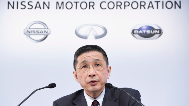 Nissan cuts outlook and books Ghosn charges