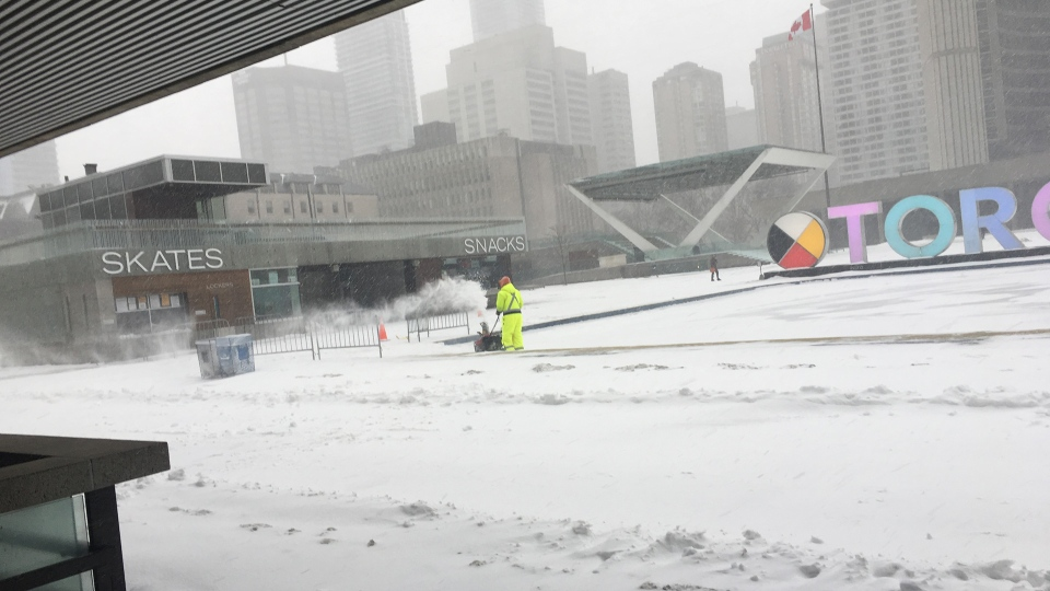 A worker with a snow blower clears snow off of the ice rink at Nathan Phillips Square in downtown Toronto during a winter storm Tuesday February 12, 2019. (Joshua Freeman /CP24)