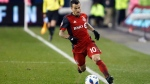 Toronto FC forward Sebastian Giovinco (10) keeps the ball in bounds as he runs up field during MLS soccer action against the Atlanta United in Toronto, Sunday, Oct. 28, 2018. THE CANADIAN PRESS/Cole Burston