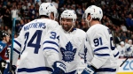 Toronto Maple Leafs center Nazem Kadri, center, celebrates scoring a goal with centers Auston Matthews, left, and John Tavares in the second period of an NHL hockey game against the Colorado Avalanche, Tuesday, Feb. 12, 2019, in Denver. (AP Photo/David Zalubowski)