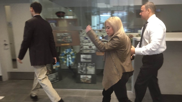 Marcella Zoia, is seen being led into a room by police at 52 Division on Feb. 13, 2019. (CP24)